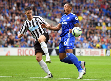 Newcastle United's Ciaran Clark (left) and Cardiff City's Kenneth Zohore battle for the ball.