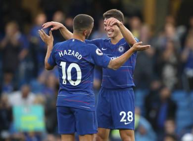 Hazard celebrates Chelsea's 3-2 win with Cesar Azpilicueta.