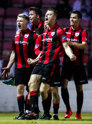 Daniel O'Reilly celebrates scoring a goal alongside his Longford team-mates.