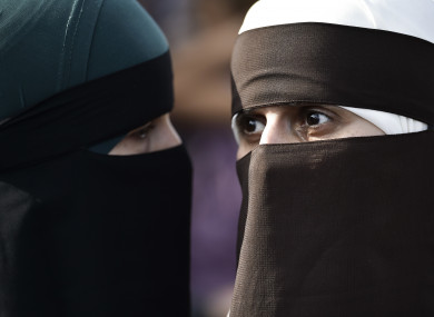 People demonstrate in Copenhagen, Denmark as the new ban on garments covering the face is implemented