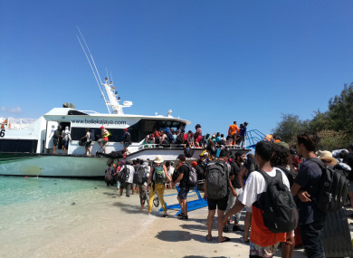 Visitors evacuate from Gili Trawangan near Lombok Island in Central Indonesia