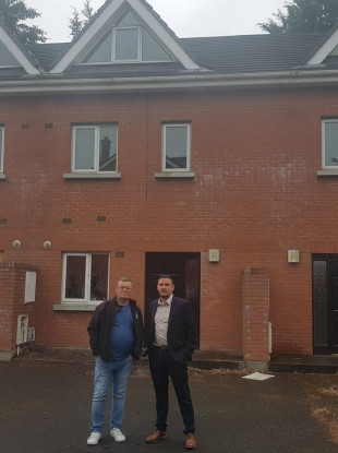 Mayor Mark Ward and local representative William Carey at the  vacant houses on Station Grove.