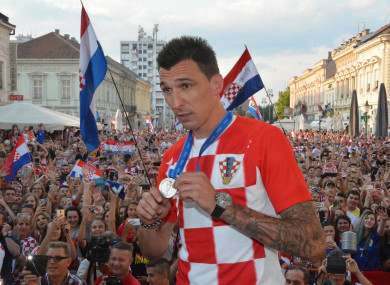 Mario Mandzukic shows off his World Cup runners-up medal at Croatia's homecoming last month.