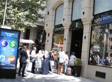Tourists outside a Louis Vuitton shop in Istanbul.