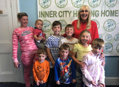 Margaret Cash and her children with RTÉ's Miriam O'Callaghan