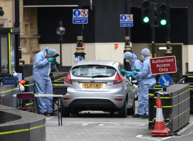 Forensic officers at the scene of the crash