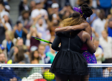 Serena and Venus Williams embrace at the US Open.