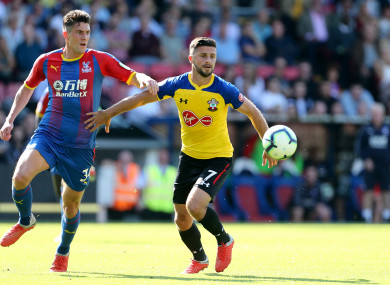 Crystal Palace's Martin Kelly (left) and Southampton's Shane Long battle for the ball.