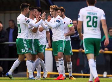 Cork's Kieran Sadlier celebrates scoring a goal with team-mates.