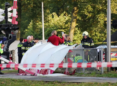 Emergency services attend the scene after a train collided with a cargo bike in the town of Oss