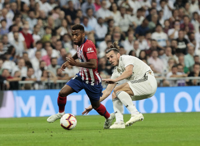 Atletico Madrid's Thomas Lemar gets away from Gareth Bale of Real Madrid during last night's La Liga fixture.