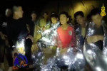 File photo: members of the Royal Thai Navy are pictured with the 12 schoolboys, members of a local soccer team, and their coach, who were trapped in the Tham Luang Cave network in Northern Thailand.