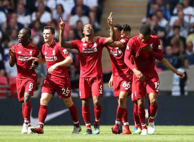 Liverpool's Georginio Wijnaldum (centre) celebrates scoring his side's first goal of the game.