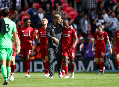 Klopp celebrates Liverpool's win at Wembley with his players.