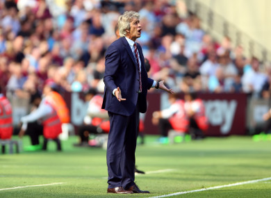 West Ham boss Manuel Pellegrini watches on from the sidelines.