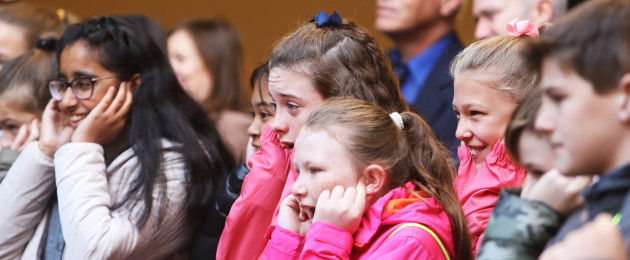 School children watch a demonstration showing the dangers of explosives to fingers and hands at the launch of Dublin Fire Brigade's Halloween safety campaign