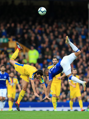 Palace's James Tomkins (left) and Everton's Richarlison tumble after challenging for the ball.