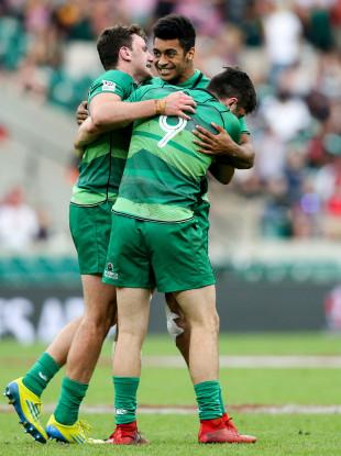 Robert Baloucoune, centre, celebrates Ireland's win over England at the Twickenham Sevens.