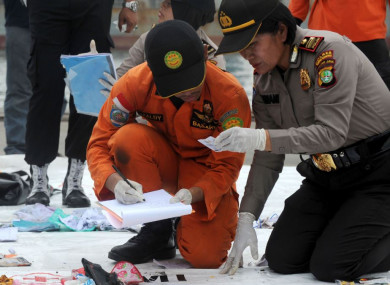 Search and Rescue members and police officers check belongings of Lion Air flight JT 610 victims in Jakarta today.