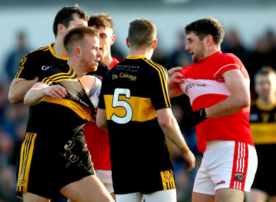 Dr. Crokes' Michael Moloney and Fionn Fitzgerald clash with Paul Geaney of Dingle.