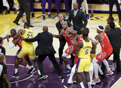 Houston Rockets' Chris Paul is held back by Los Angeles Lakers' LeBron James.
