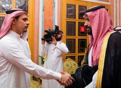Saudi Crown Prince Mohammed bin Salman, right, shakes hands with Salah Khashoggi (victim's son) after they received him in Riyadh, Saudi Arabia.