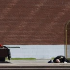 A soldier of the Kremlin subdivision collapse from heat exhaustion near the Tomb of Unknown Soldier in downtown Moscow. (AP Photo/Misha Japaridze)