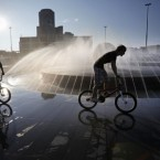 Boys ride bicycles at a fountain try to cool themselves in the Ural Mountains city of Yekaterinburg, about 1500 km (900 miles) east of Moscow. (AP Photo/Alexander Zemlianichenko)