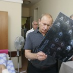 The patient looks suitably worried that his prime minister is getting involved in his treatment. Putin visits air force pilot Vyacheslav Malkov (in bed) after his plane was shot down by Georgian forces in August 2008. (AP Photo/RIA-Novosti, Alexei Druzhinin, Pool)<span class=