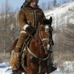 Not a man to be stopped by seriously inclement weather, Putin heads off into the Siberian hills on horseback in February. (AP Photo/RIA Novosti, Alexei Druzhinin, Pool)<span class=