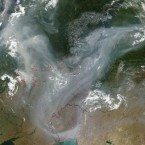 This true-color image from the Moderate Resolution Imaging Spectroradiometer (MODIS) on NASA's Terra satellite acquired 5 August, 2010 shows smoke from fires burning across western Russia. On Friday, visibility in parts of the capital was down to a few dozen yards (meters) due to the smog caused by the fires, which carries a strong burning smell and causes coughing. <span class=