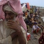 People take shelter on higher ground due to flooding in an area of Jaffarabad, Pakistan.  (AP Photo/Fida Hussain)