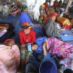 Villagers who flee erupting Mount Sinabung rest at a temporary shelter in Karo, North Sumatra, Indonesia, 29 August, 2010. (AP Photo/Binsar Bakkara)<span class=