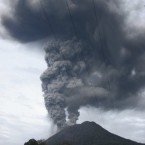 Mount Sinabung spews volcanic materials into the sky in Karo, North Sumatra, Indonesia, 30 August, 2010. (AP Photo/Roone Patikawa)<span class=