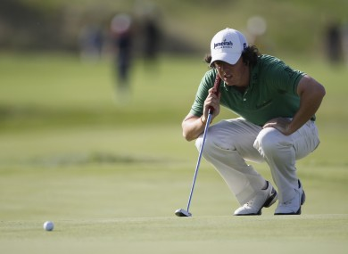 McIlroy of Northern Ireland lines up a putt during the final round of the PGA Championship golf tournament