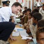 Britain's Deputy Prime Minister Nick Clegg speaks to a boy in an improvised school-room in a camp for people displaced by the floods, near the town of Sukkur, during a visit to southern Pakistan on 1 September, 2010. (Andrew Winning/PA Wire/Press Association Images)<span class=