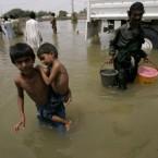 People walk in flooded area of Sajawal near Hyderabad, Pakistan on 1 September, 2010. (AP Photo/Shakil Adil)<span class=