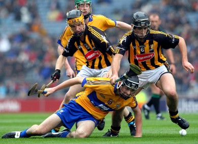 Kilkenny's Pat O'Carroll and Luke Harney tackle Cathal Malone of Clare