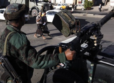 A Yemeni soldier mans a heavy machine gun on top of an army vehicle at a check point in the capital San'a, Yemen, earlier this year.