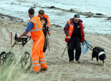 Investigators begin their search for the remains of Peter Wilson on a beach at Waterfoot, Co Antrim.