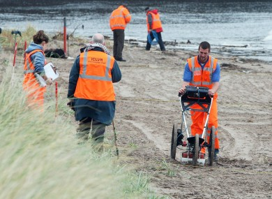 Forensic offers on the beach at Waterfoot in Co Antrim, where the search for Peter Wilson uncovered a human body earlier today.