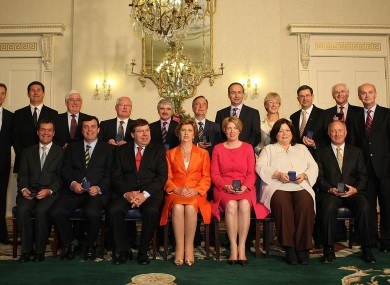 Mary McAleese (centre, orange) will voluntarily cut her pay by 23% next year, while the Taoiseach (to the left) will have his wage cut by 14% and other ministers by 10%.