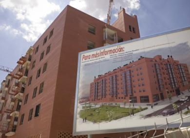 Photo from 15 July, 2008, showing a sign displaying apartments for sale is seen at the building construction site in Madrid.