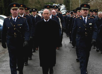 Outgoing Garda commissoner Fachtna Murphy, justice minister Dermot Ahern, and Deputy and incoming Garda Commissioner Martin Callinan.