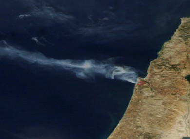Satellite image released by NASA shows smoke drifting away from the fires outside Haifa, Israel.