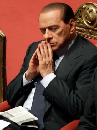 Italian Premier Silvio Berlusconi ponders after delivering his message at the Senate, in Rome, Monday, Dec. 13, 2010.