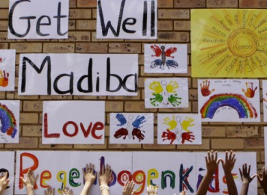 Children reach up to wish Nelson Mandela, or 'Madiba', well before his hospital discharge today.