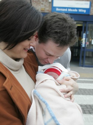 Nick Clegg kisses the forehead of his newborn son, Miguel, in February 2009.