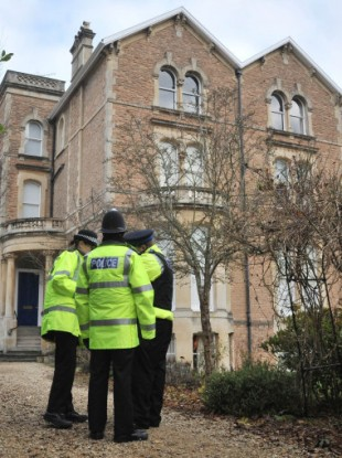 Police outside the building in Briston where Chris Jefferies and Joanna Yates lived in separate residences.