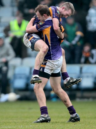 Crokes' Liam Og O Heineachain and Paddy Duggan celebrate at the final whistle.